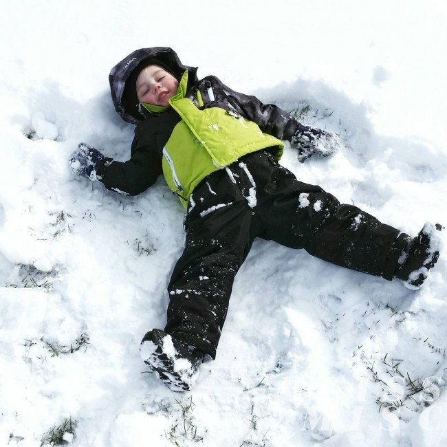 Making snow angels with brother snowday snowbaby