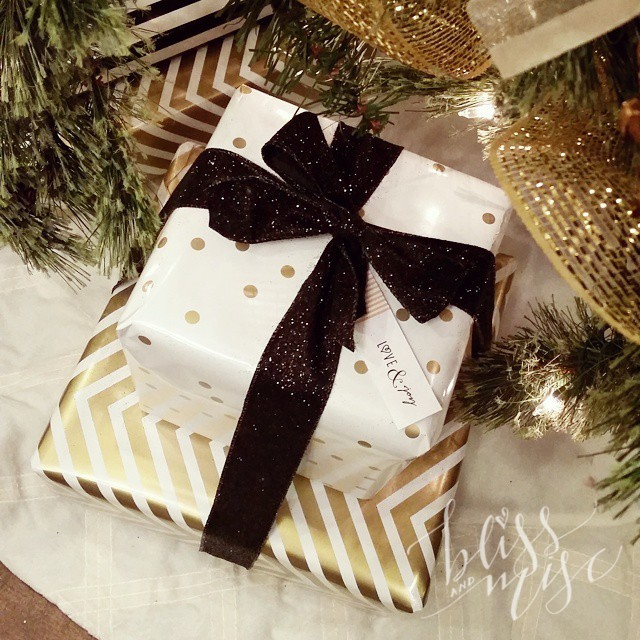 Kind of wanting a seasonal job as a gift wrapper :) #giftwrap #beautifulboxes #glitter #bows #goldandblack